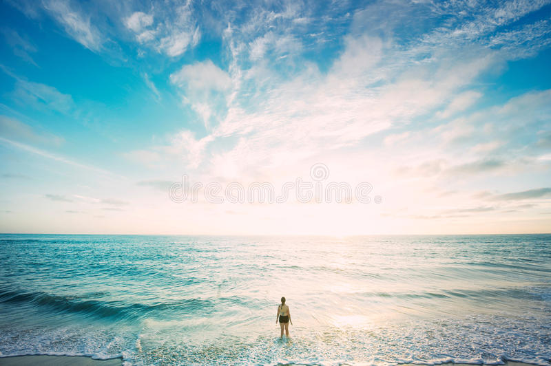 Woman Standing Facing Ocean Under White And Blue Sky Free Public Domain Cc0 Image
