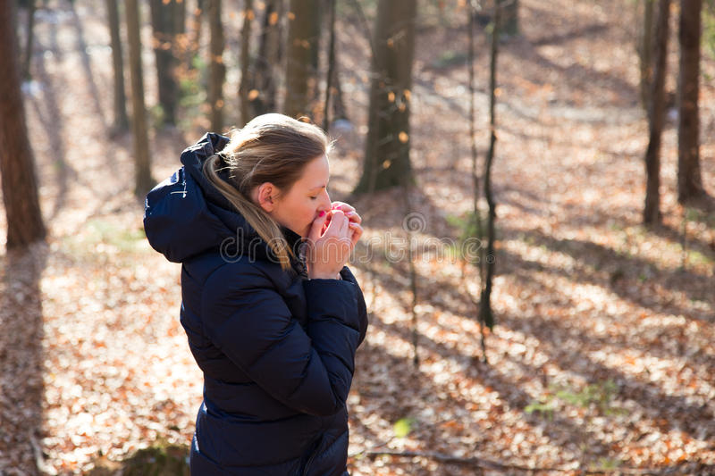 Woman standing in the forest stock photo