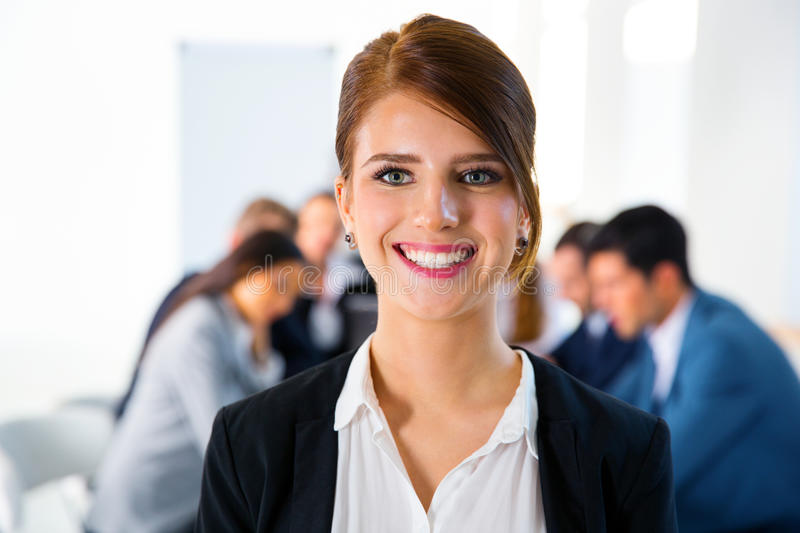 Woman standing in front of a business meeting royalty free stock photos