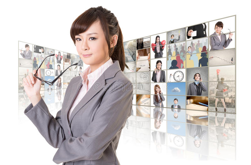 Woman standing in front of TV stock image