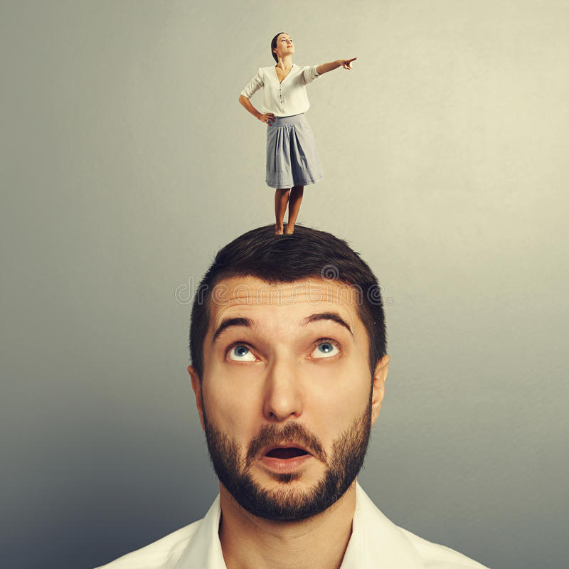 Download Woman Standing On The Head Of Amazed Man Stock Photo - Image: 37684834