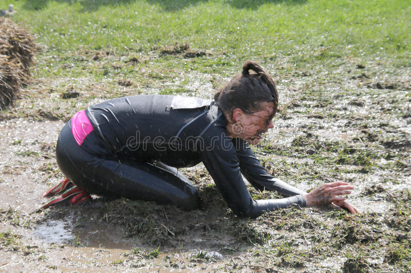 Woman standing on her knees through the mud royalty free stock photos
