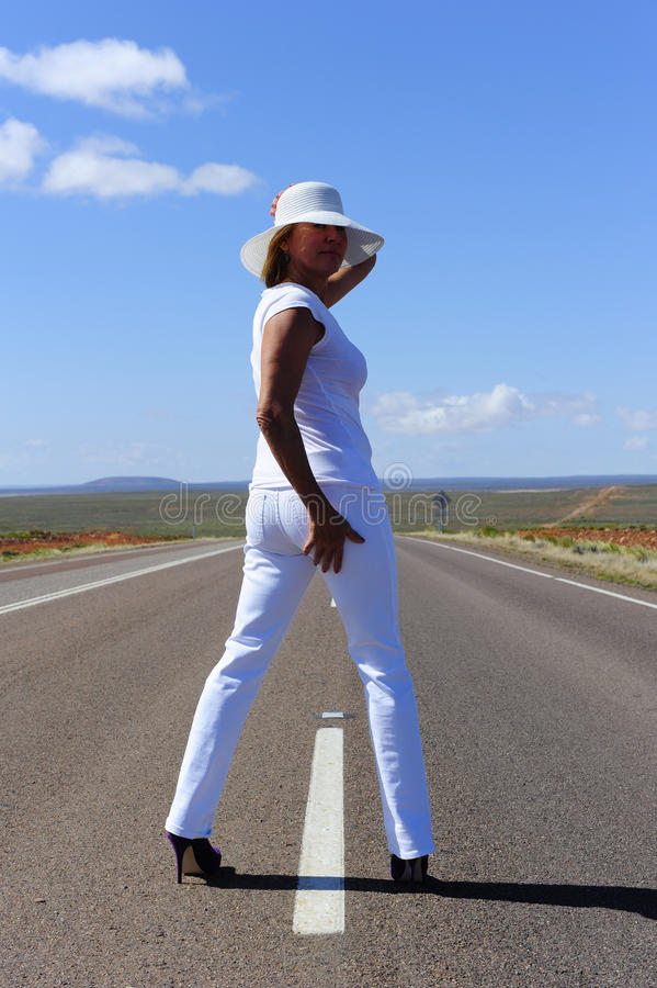 Woman Standing on Highway royalty free stock photo