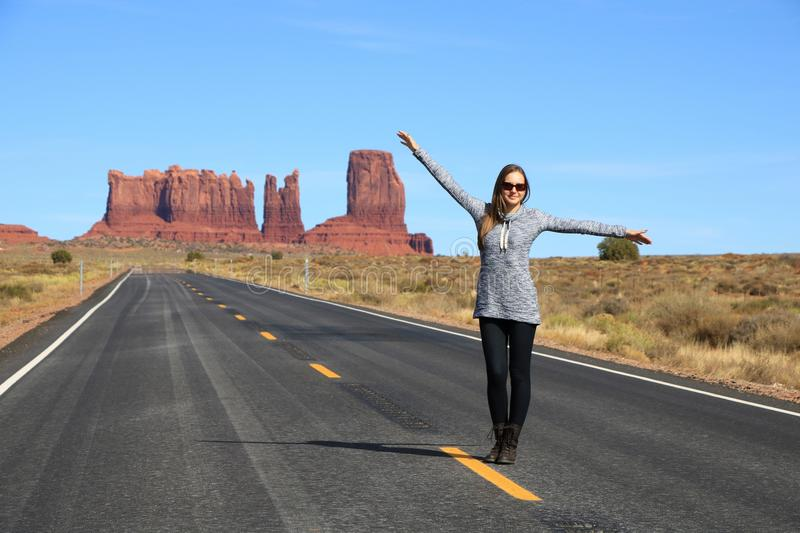 Woman Standing on a Highway in the Desert stock photography
