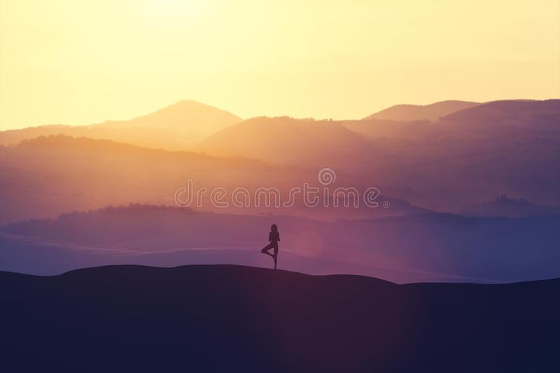 Woman standing on the hill, practicing yoga. vector illustration