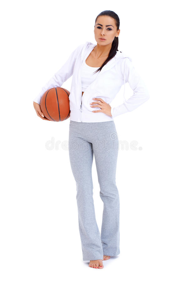 Woman Standing And Holding Basketball Royalty Free Stock Photography