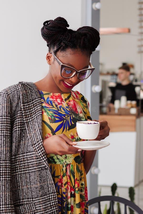 Woman Standing Holding Coffee Mug royalty free stock image