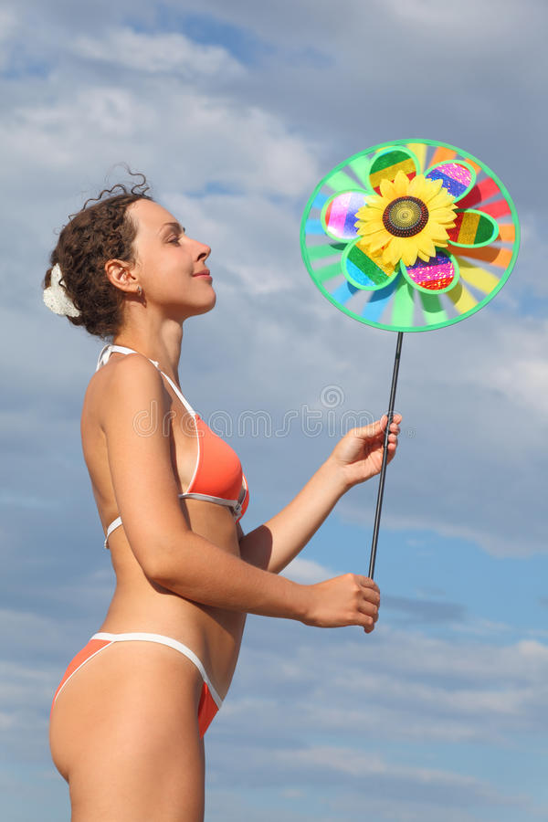 Woman Standing And Holding Pinwheel Toy Stock Photography