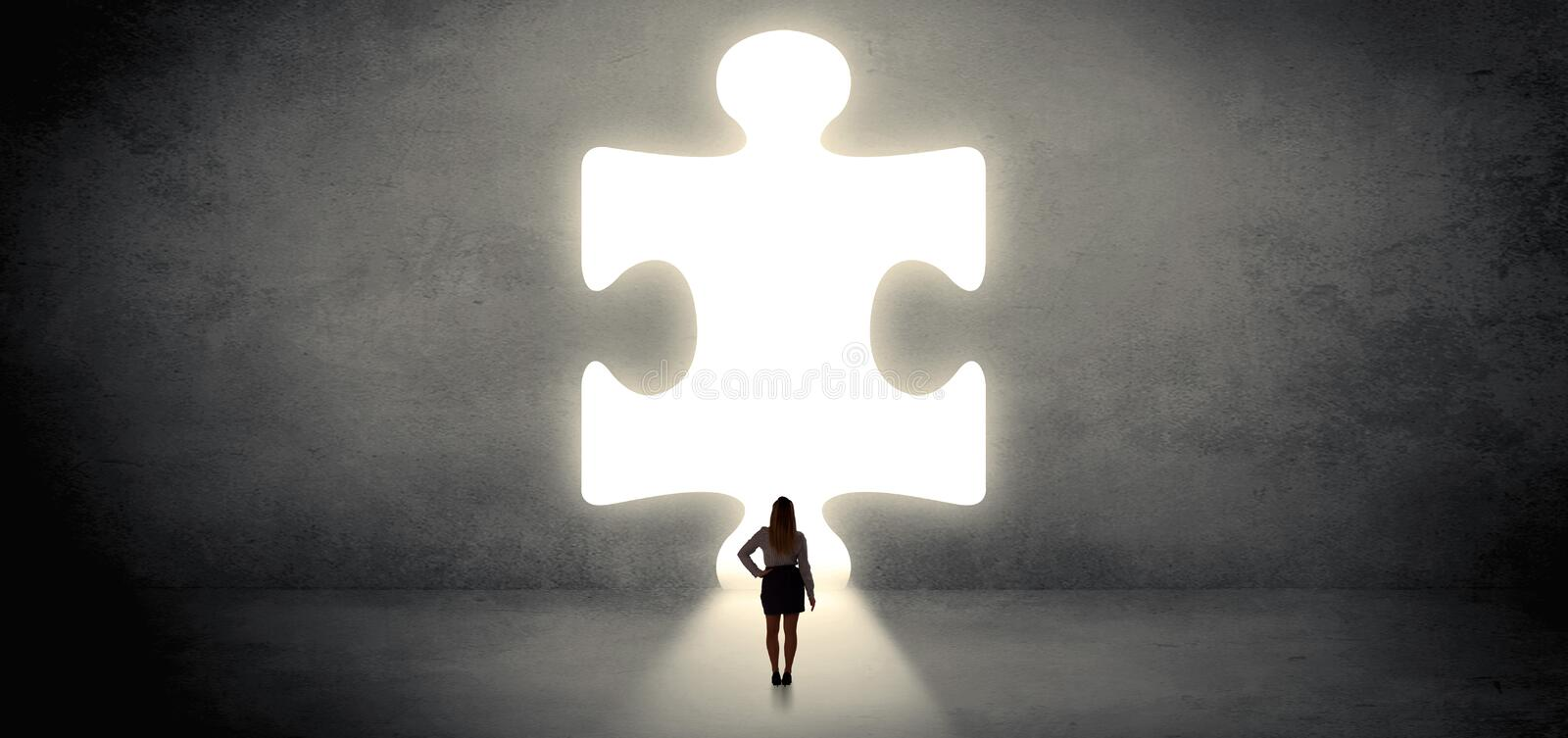 Woman standing in front of a big puzzle piece royalty free stock photography