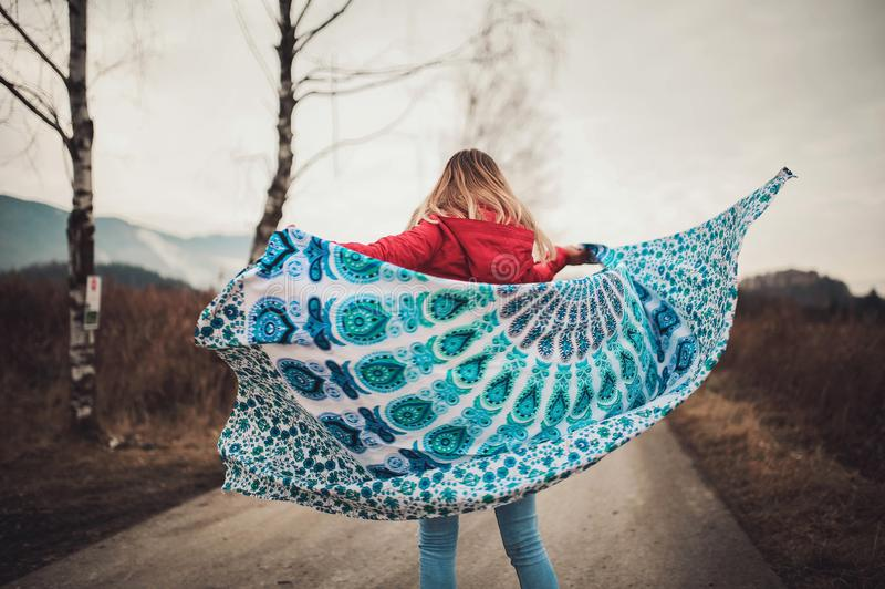 Woman Standing on the Middle of the Road Holding Blanket royalty free stock photo