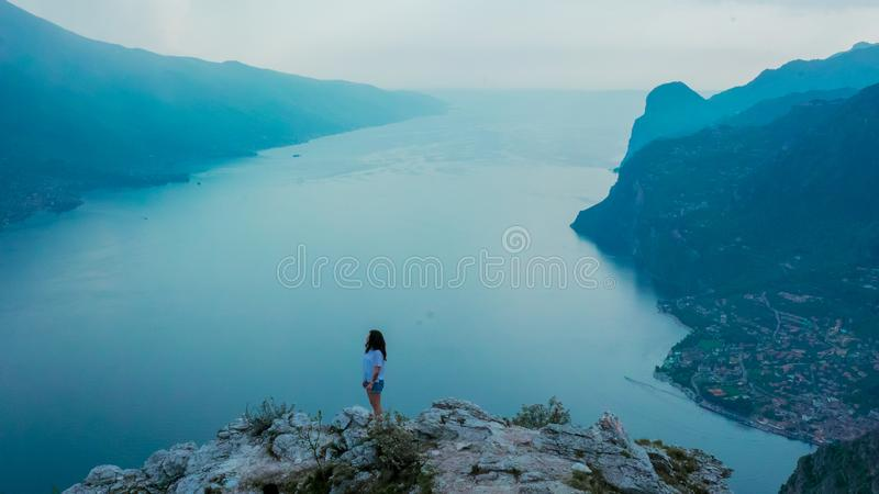 Woman Standing on Mountain during Dayttime royalty free stock images