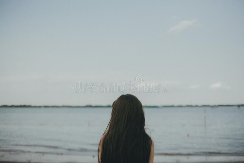 Woman Standing Near Body Of Water During Daytime Free Public Domain Cc0 Image