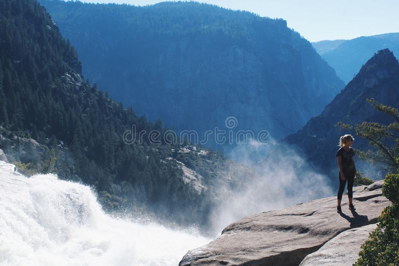 Woman Standing Near Mountain Cliff royalty free stock photo