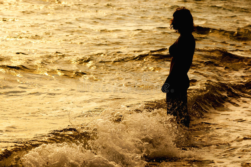 Woman is standing near the sea stock image