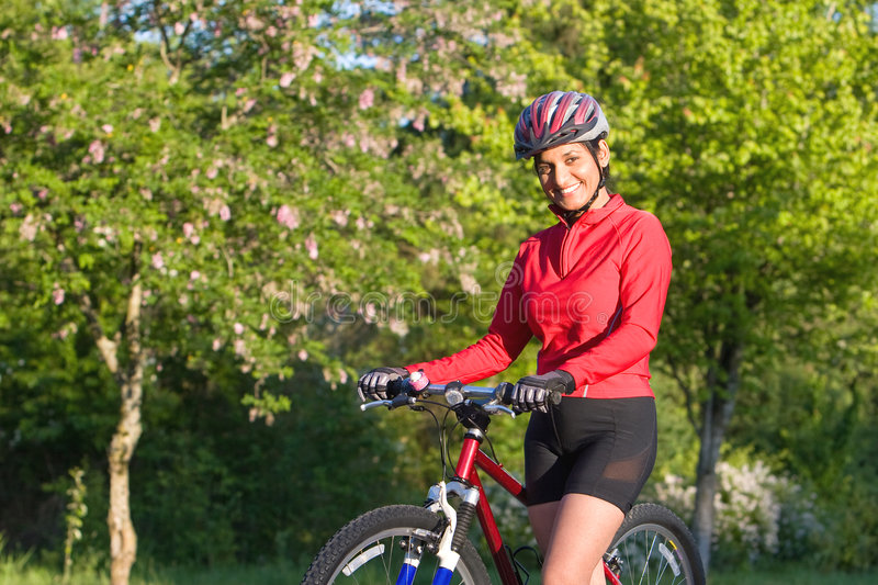 Woman Standing Next To Bicycle - Horizontal Stock Images
