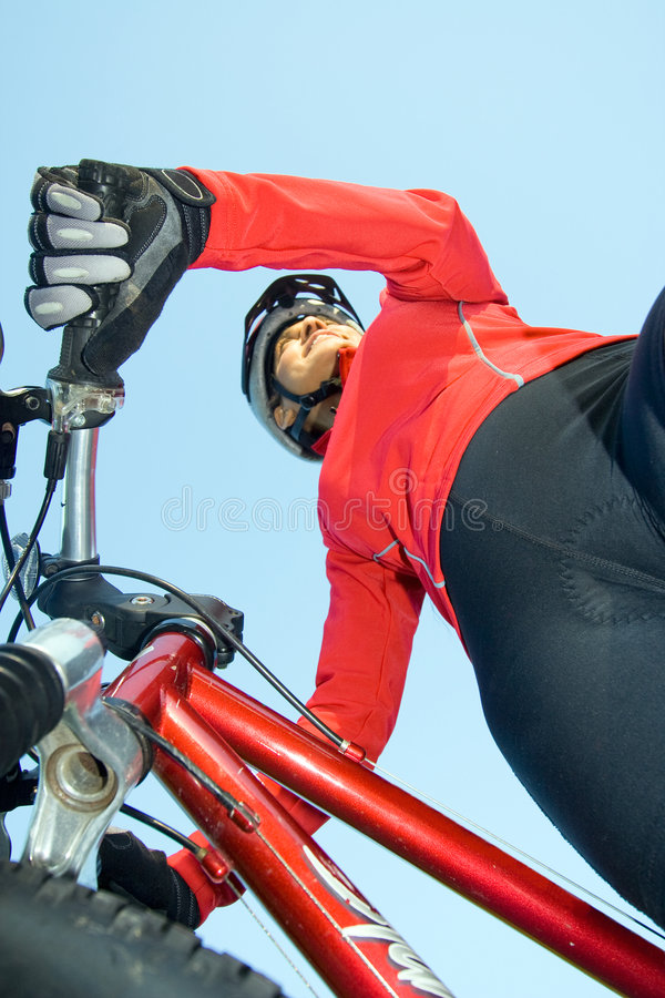 Download Woman Standing Next To Bicycle - Vertical Stock Photo - Image: 5615896