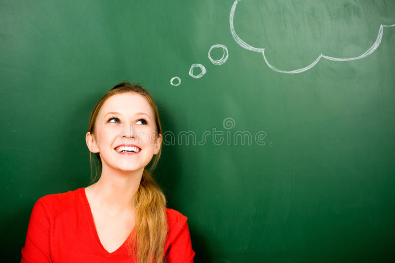 Woman standing next to thought bubble stock photo