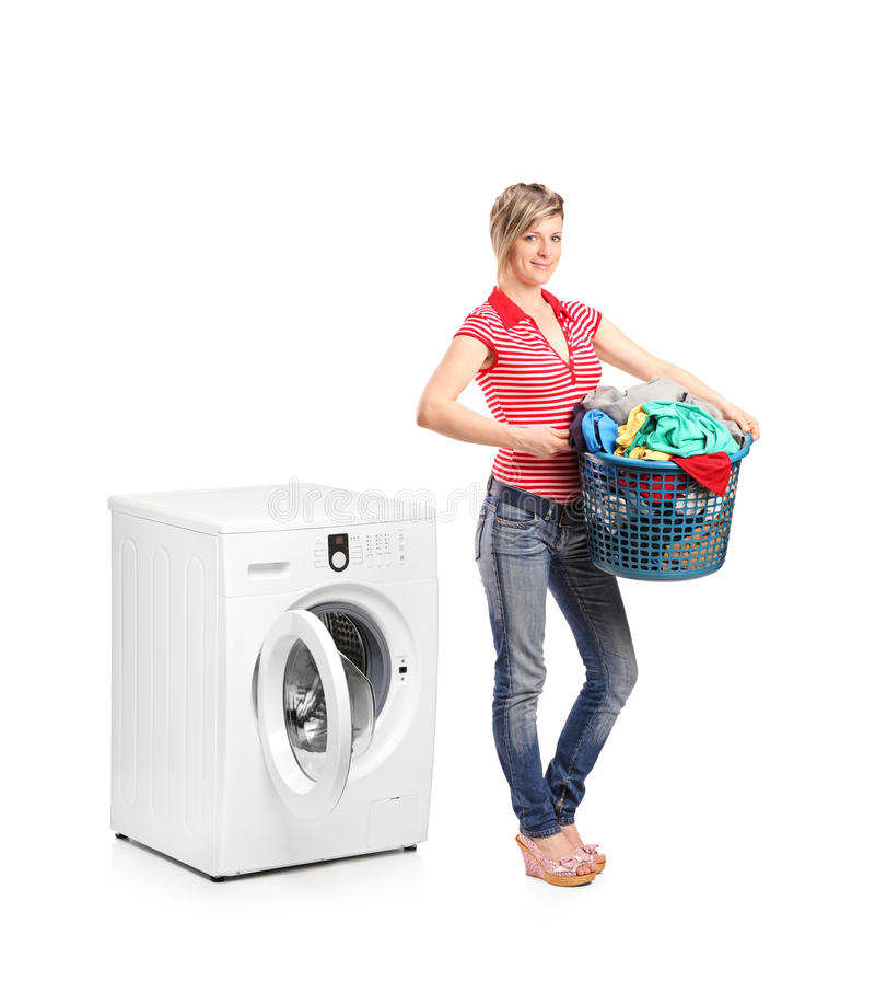 Download Woman Standing Next To A Washing Machine Stock Photo - Image: 20529474