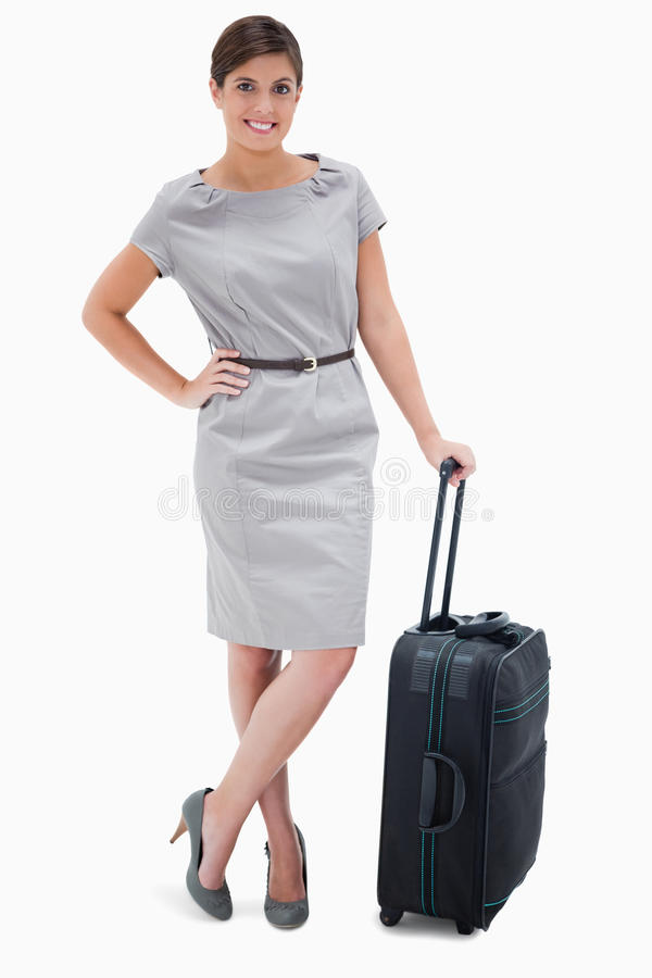 Woman Standing Next To Wheely Bag Royalty Free Stock Photography