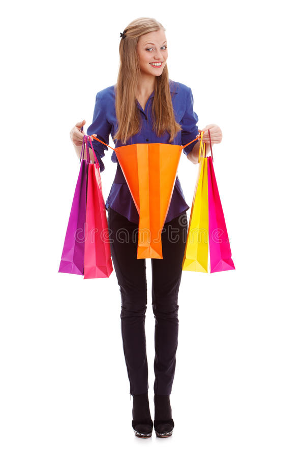 Woman standing with opened shopping bag