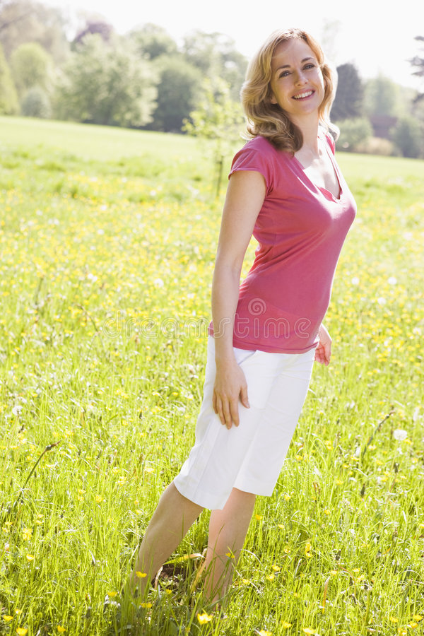 Download Woman Standing Outdoors Smiling Stock Image - Image: 5935867