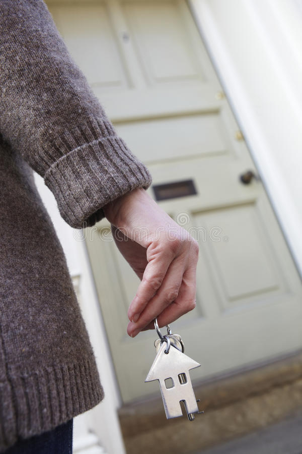 Download Woman Standing Outside New Home Holding Key Stock Image - Image: 27104741