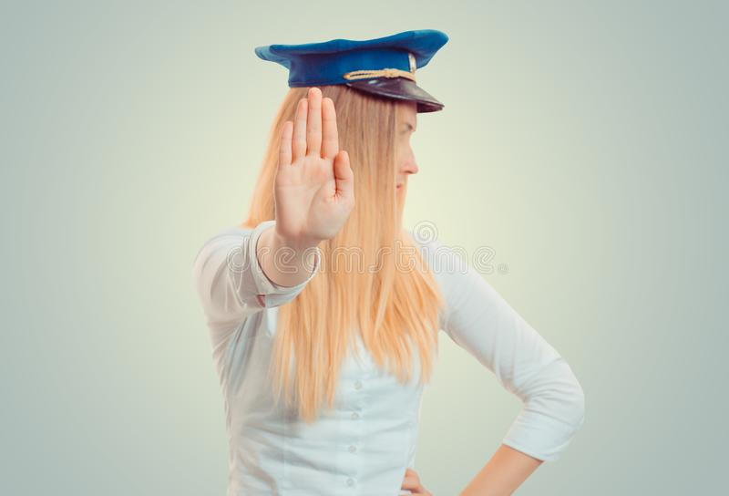 Woman standing with outstretched hand showing stop, no gesture. stock photography