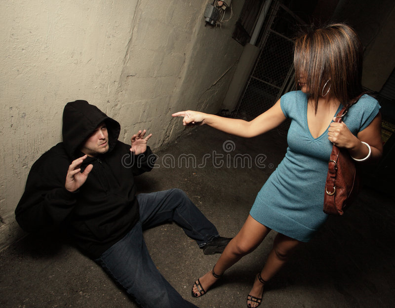 Download Woman Standing Over The Robber Stock Photo - Image: 8731726