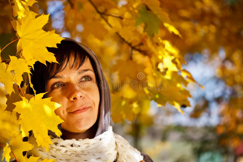 Woman standing in a park stock photo