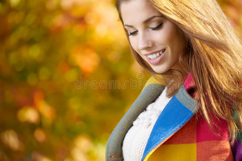Download Woman Standing In A Park In Autumn Stock Photography - Image: 34298772