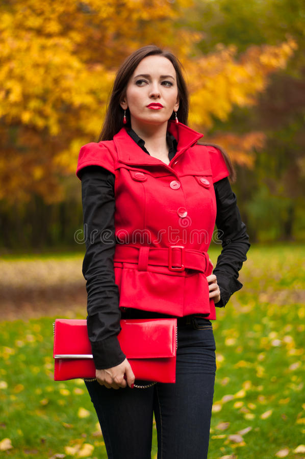 Woman standing in the park stock photos