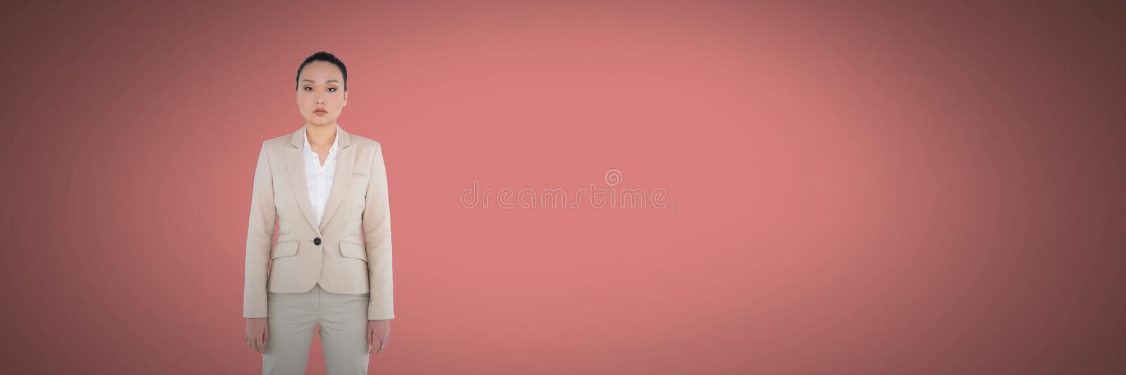 Woman standing in pink space royalty free stock photography