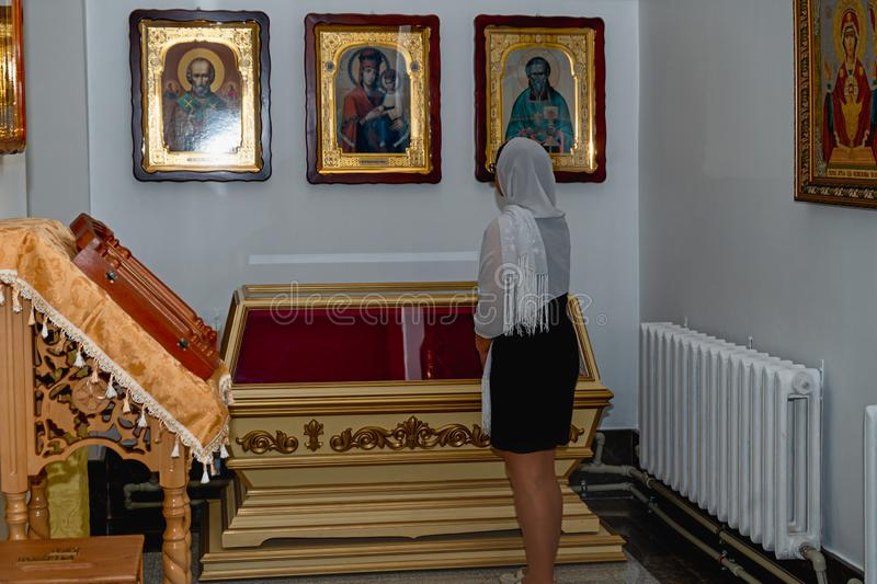 Woman in Orthodox church. Woman standing and praying in Orthodox church. Belarus, Starobin, June 23, 2018 stock images