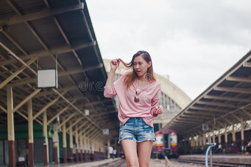 Woman standing on a railroad track royalty free stock photography