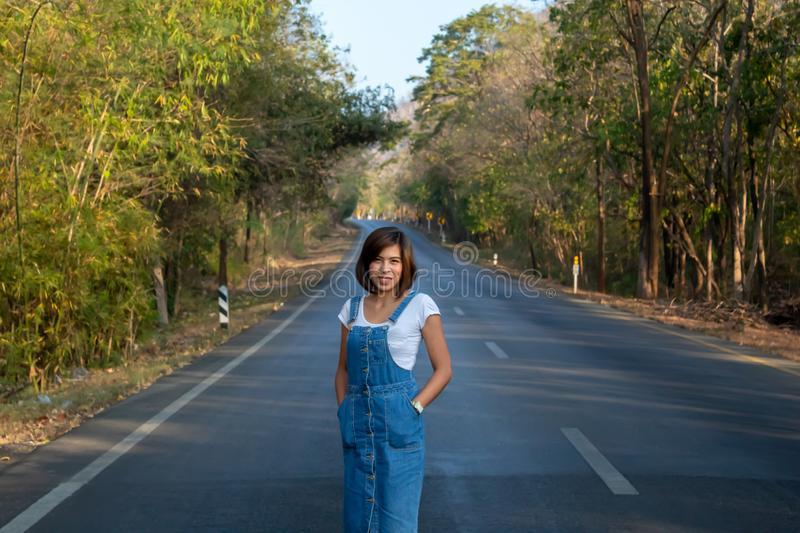 The woman standing on the road, with nature trails green royalty free stock photos