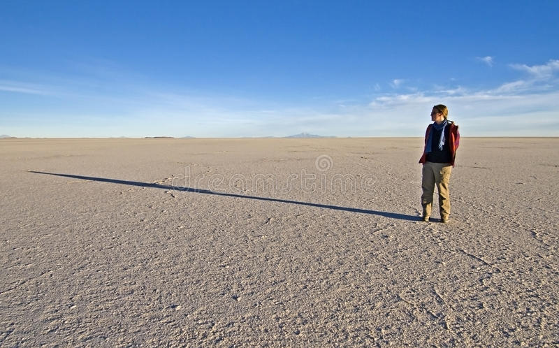 Woman Standing On Salt Flats Royalty Free Stock Images
