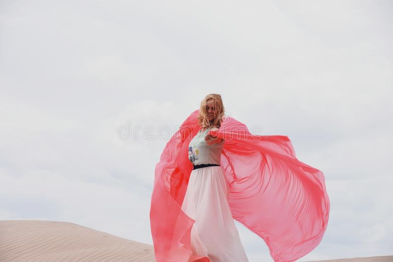 Woman standing in sand dunes royalty free stock images
