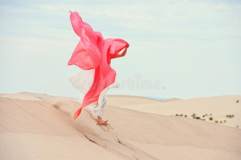 Woman standing in sand dunes stock images