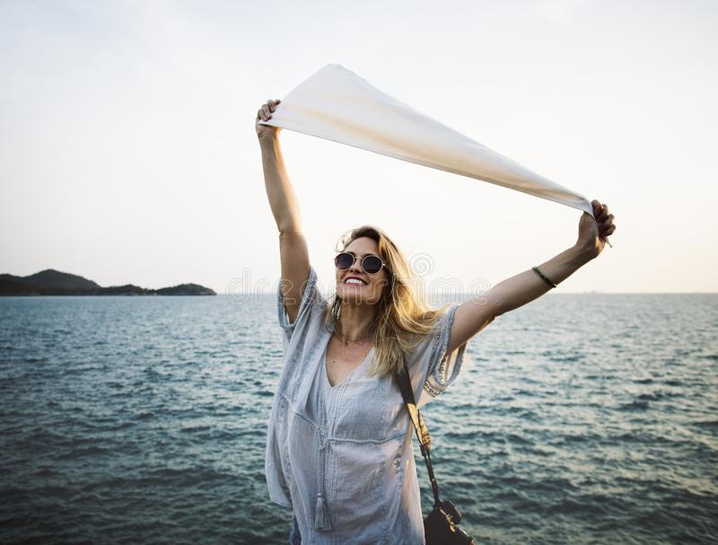 Woman standing beside the sea royalty free stock images