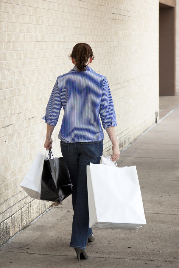Download Woman Standing With Shopping Bags At Mall Stock Photo - Image: 16462578
