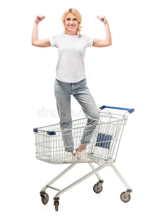 smiling caucasian woman standing in shopping cart stock photos