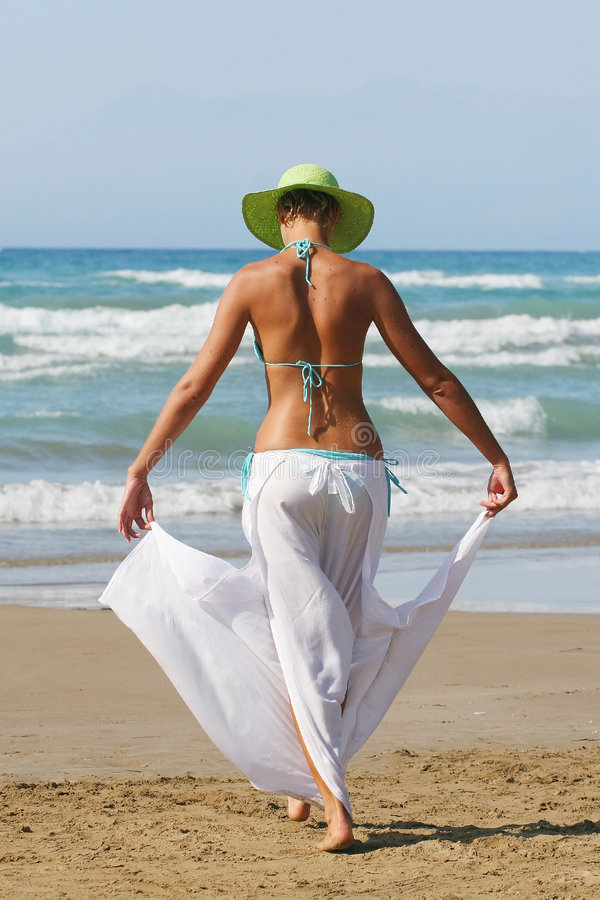 Download Woman Standing On Shoreline At The Beach Stock Photo - Image: 6294962