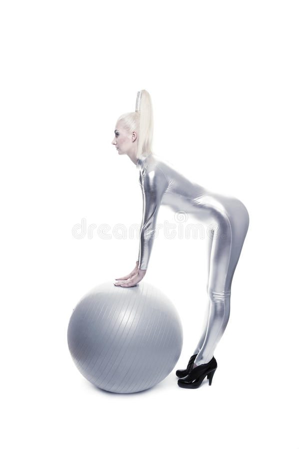 Woman standing with a silver ball stock images
