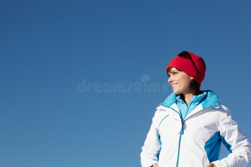 Woman Standing In Snow