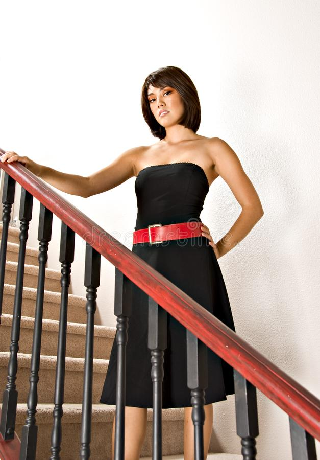 Woman standing on staircase royalty free stock photo