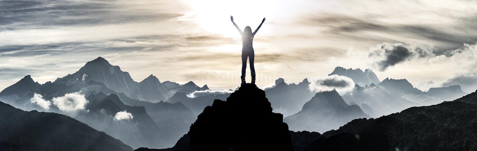 Woman standing at a summit. With hands ahead royalty free stock images