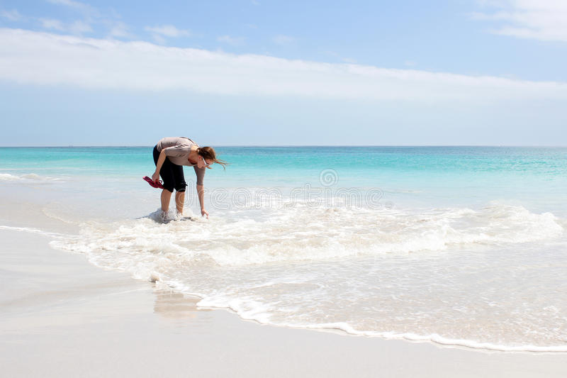 Woman standing in Water stock image
