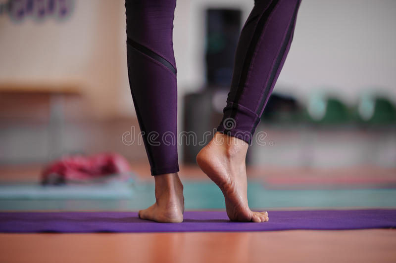 Woman standing at yoga class stock images