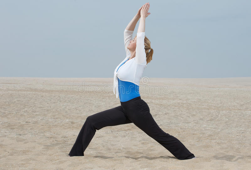 Download Woman Standing In Yoga Postion At Beach Stock Photo - Image: 32625920