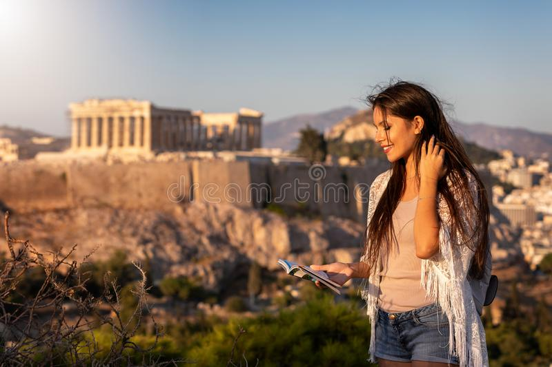 Woman stands in front of the Acropolis of Athens, Greece royalty free stock photos